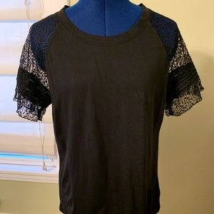 Black T-shirt with lace sleeves.